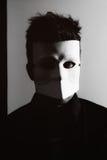 Man wearing white masquerade mask Stock Photos