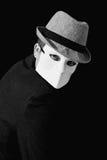 Man wearing white masquerade mask Stock Photography