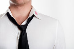 Man wearing white shirt covered by red lipstick kisses Stock Photo