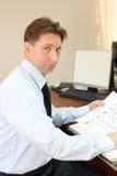 Man wearing white shirt sit at table Stock Photos