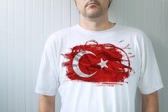 Man wearing white shirt with Turkey flag print Royalty Free Stock Photos