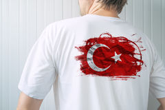 Man wearing white shirt with Turkey flag print Stock Image