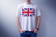 Man wearing white shirt with UK flag print. Man wearing white shirt with United Kingdom flag print, adult male person supporting Great Britain Stock Images
