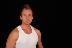 Man wearing white undershirt Stock Photos