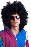 Man wearing wig and sunglasses Stock Images