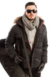 Man wearing winter clothes ready to travel Royalty Free Stock Photo