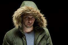 Man wearing winter coat Stock Images