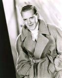 Man wearing wrap coat Stock Photography