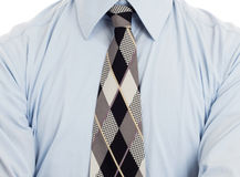 Man wearing wrinkled blue shirt with necktie, isolated. On white Stock Photography