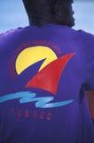 Man wearing Yachting Regatta T-shirt Tobago. Royalty Free Stock Images