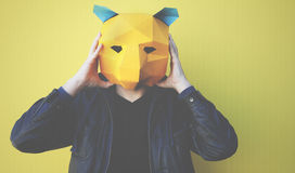 Man wearing a yellow bear mask Royalty Free Stock Photos