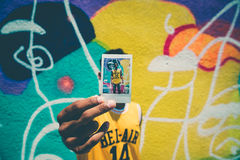 Man Wearing Yellow Bel-air 14 Jersey Shirt Holding Basketball Trading Card Stock Image