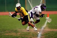 Man Wearing Yellow and Black Sport Jersey Holding Lacrosse Stick Stock Photo
