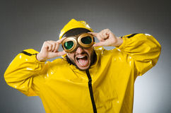 Man wearing yellow suit and aviator glasses. The man wearing yellow suit and aviator glasses Stock Images