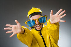 Man wearing yellow suit Stock Images