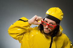 Man wearing yellow suit Stock Image