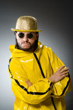 Man wearing yellow suit Stock Photo