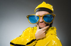 Man wearing yellow suit in funny concept Stock Image