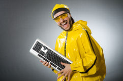 Man wearing yellow suit with keyboard Stock Image