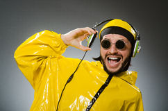 Man wearing yellow suit listening to headphones Royalty Free Stock Photo