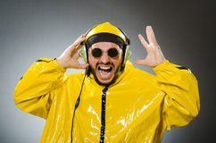 Man wearing yellow suit listening to headphones Stock Photography