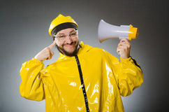 Man wearing yellow suit with loudspeaker Stock Photography