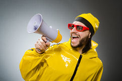 Man wearing yellow suit with loudspeaker Royalty Free Stock Images
