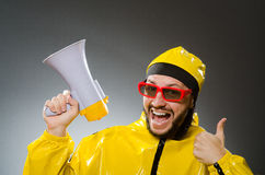 Man wearing yellow suit with loudspeaker Royalty Free Stock Photography