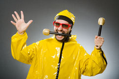 Man wearing yellow suit with mic Stock Images