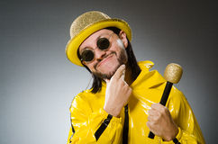 Man wearing yellow suit with mic Stock Photo
