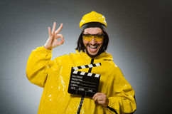Man wearing yellow suit with movie board Royalty Free Stock Images