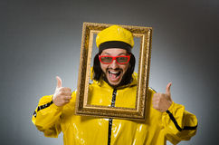 Man wearing yellow suit with picture frame Stock Photos