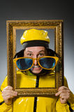 Man wearing yellow suit with picture frame Stock Image