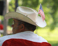 Man wears cowboy hat with American Flag at Tea Party Rally. Man wearing a cowboy hat with an American Flag on it at a Tea Party Rally at a park with American Stock Images