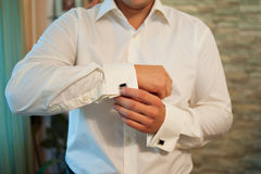 Man wears cufflinks on French cuffs sleeves luxury white shirt Stock Images
