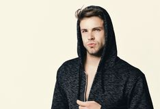 Man wears dark grey sweater or hoodie. Fashion and sport royalty free stock photography