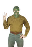 Man wears green camouflage mask and shows Victory sign Stock Images