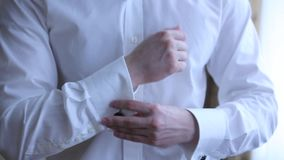 Man wears shiny cufflinks. Close up stock video