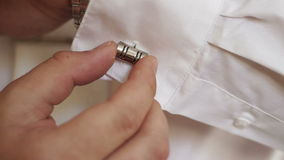 Man wears shiny cufflinks stock footage