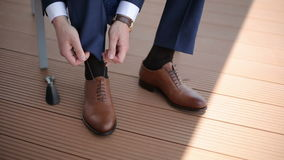 The man wears shoes. Close up stock video footage