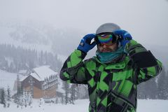 A man wears a ski mask. recreation skier in the mountains royalty free stock photography