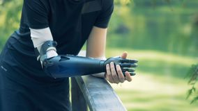 A young man with bionic prosthesis, close up. Man wears a technological prosthesis