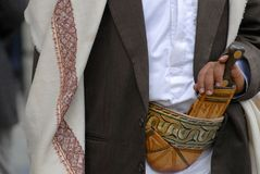 Man wears traditional Yemeni dagger janbiya. Royalty Free Stock Photos