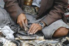 Man wears traditional Yemeni dagger janbiya. Royalty Free Stock Photos