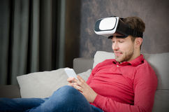 Man wears virtual reality glasses with smartphone inside Royalty Free Stock Photos