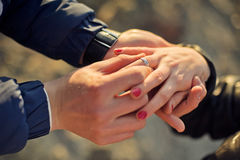 Man wears a wedding ring on woman's hand Royalty Free Stock Photo