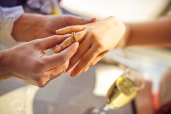 The man wears a wedding ring on woman's hand Stock Image