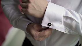 Man wears white cufflinks stock video