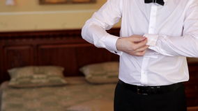Man wears white shirt and cufflinks stock video