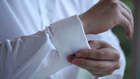 The man wears white shirt and cufflinks stock video footage